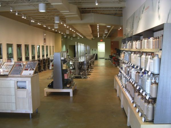 Interior image of of empty student salon with shelves of beauty products